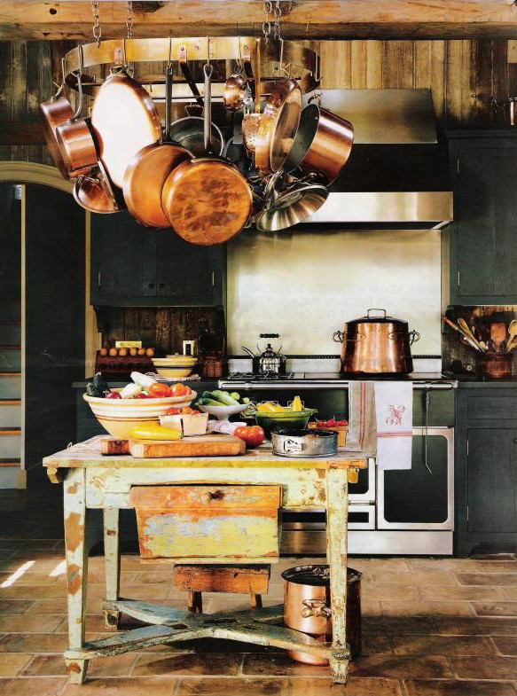 kitchen with black cabinets, French range and barn wood on the walls - House & Garden via Atticmag