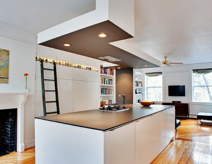 library ladder kitchens - white Ikea kitchen with library ladder and two-tier cabinets - dwell via Atticmag