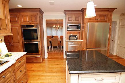 custom cherry kitchen - Miele ovens and Amana refrigerator in custom cherry kitchen - Margie Berg via Atticmag