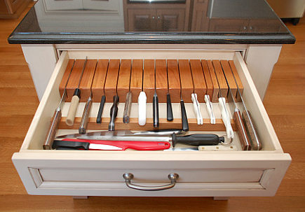 cherry kitchen - knife drawer in white-painted work table island - Margie Berg via Atticmag