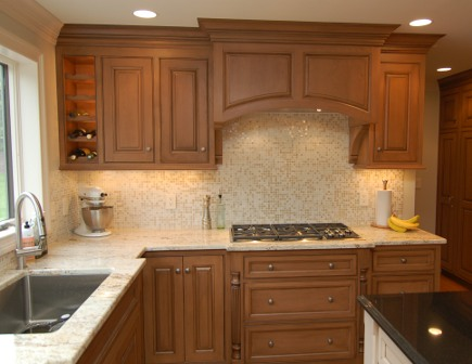Wolf gas cooktop in custom cherry kitchen - Margie Berg via Atticmag