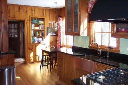 new knotty pine kitchen with green counters - gardenweb via atticmag