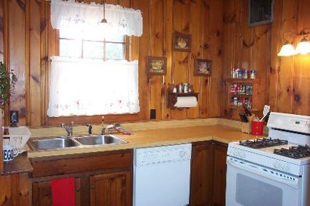 knotty pine kitchen before renovation - gardenweb via Atticmag