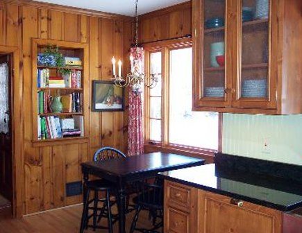 original knotty pine breakfast nook viewed from the new kitchen - gardenweb via atticmag
