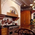 tin tile ceiling kitchen with antiques and elaborate detailing - via Atticmag