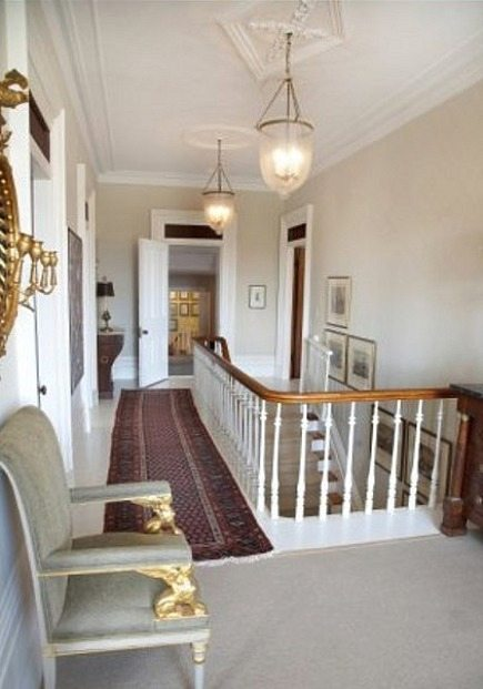 stone mansion - upstairs landing with antique lanterns hanging from plaster ceiling medallions in Canada's historic Maus Park outside Toronto - mauspark via atticmag