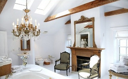 stone mansion - elegant master bath with skylights, bidet, fireplace and antique chandelier in Canada's historic Maus Park outside Toronto - mauspark via atticmag