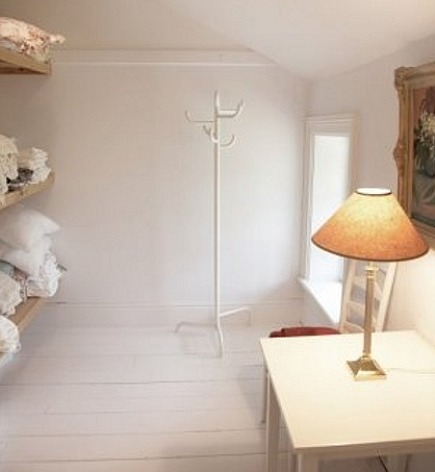 stone mansion - walk in attic linen closet with oil panting in Canada's historic Maus Park outside Toronto - mauspark via atticmag