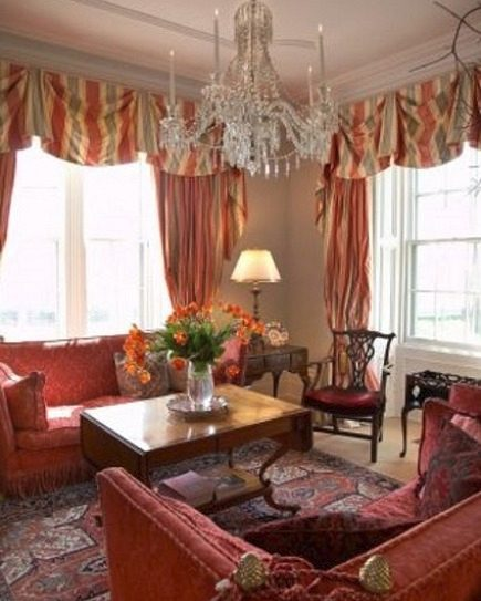 stone mansion - colorful living room at Canada's historic Maus Park outside Toronto with red-upholstered Knole sofas and tent stripe drapery - mauspark via atticmag