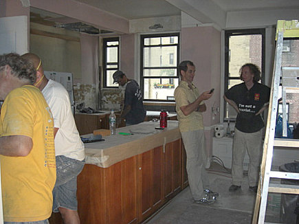 new apartment kitchen - crews in the NY apartment kitchen during the renovation - Atticmag