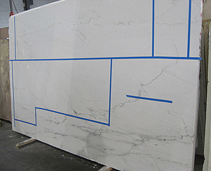 new apartment kitchen - Castle White marble slab taped off for counter fabrication - Atticmag