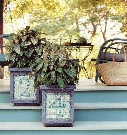 concrete planters with mosaic house numbers as a porchside address - Martha Stewart Living via Atticmag