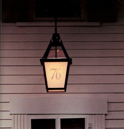 address numbers reverse painted on a light fixture