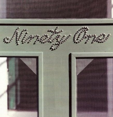 cottage screen door with house numbers written in script with nailheads - Martha Stewart Living via Atticmag