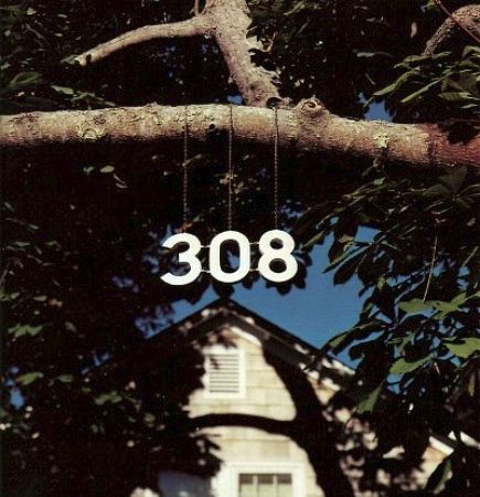 metal house numbers address hanging from tree - Martha Stewart Living via Atticmag
