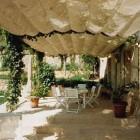 covered porches - canvas covered porch in Provence via Atticmag