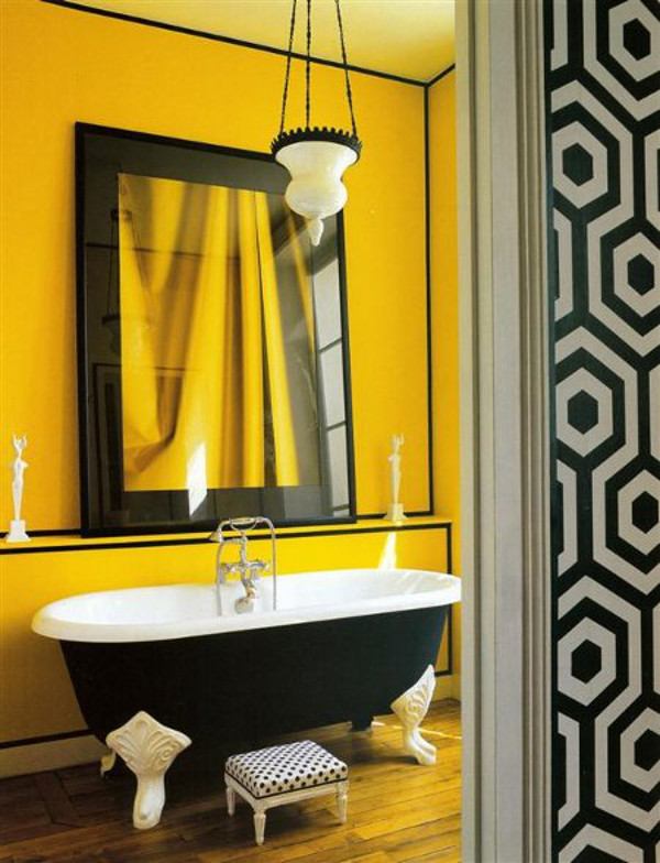 sunflower yellow bathroom with black and white trim and accessories - World of Interiors via Atticmag