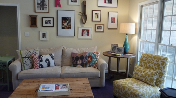 informal picture wall - how to arrange a picture wall over a sofa - Atticmag