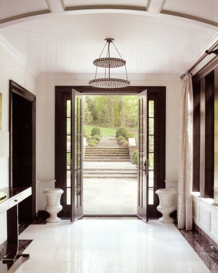 mid century - marble entry hall with vintage chandelier - New York Spaces via Atticmag