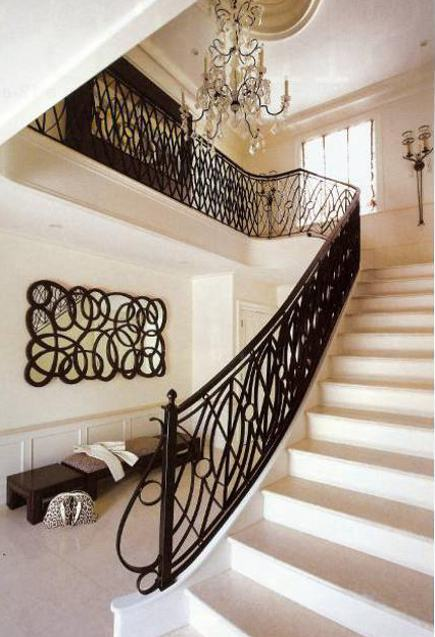 mid century - marble entry hall staircase with wrought iron loops - New York Spaces via Atticmag