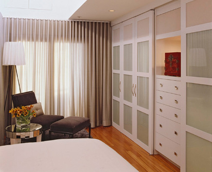 A Sliding Door Closet Closet Converted A Condo Bedroom Into A Modern  Double Duty Storage Zone.