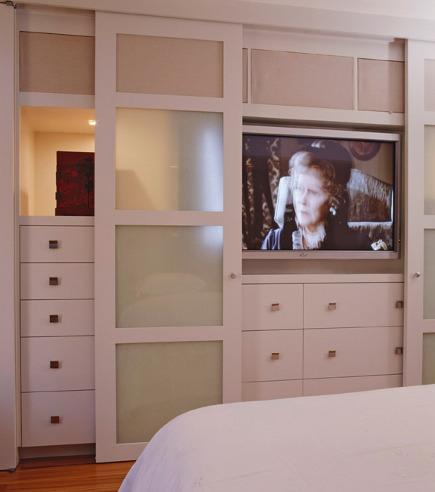 Sliding Door Closet   Narrow Doors Expose Storage And TV On A Built In  Bedroom