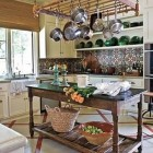 patterned tile backsplashes - hand-painted tile backsplash in rustic browns and blues - House Beautiful via Atticmag