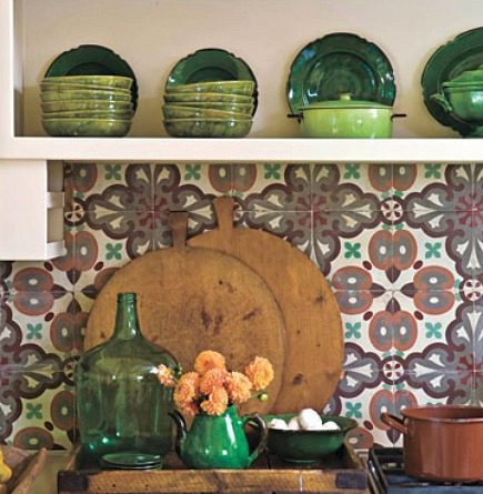 detail of hand painted tiles in rustic kitchen from House Beautiful via Atticmag