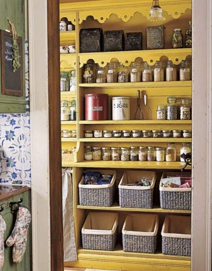 pantry ideas - open yellow pantry with wicker basket and glass jar storage - via Atticmag