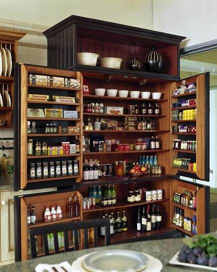 pantry ideas - English larder cabinet with storage shelves on the doors - via Atticmag