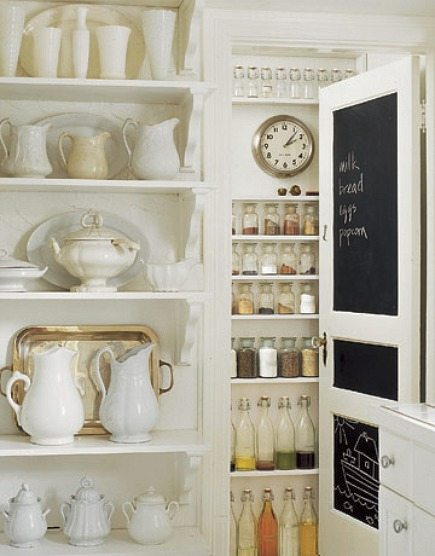 pantry ideas - white kitchen pantry with paneled chalkboard door -Country Living via Atticmag