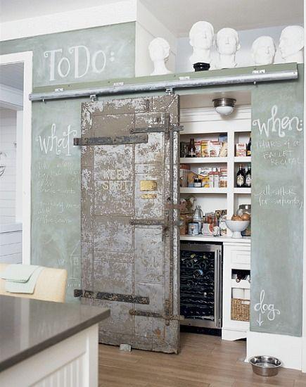 pantry ideas - kitchen pantry hidden by interior industrial sliding barn door - via Atticmag