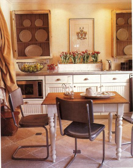 kitchen cabinet doors - cottage kitchen with see-through screen doors on makeshift upper cabinets - Country Living via Atticmag