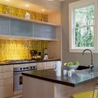 gray and yellow kitchen with yellow custom embossed Heath Tile backsplash - Heath via Atticmag