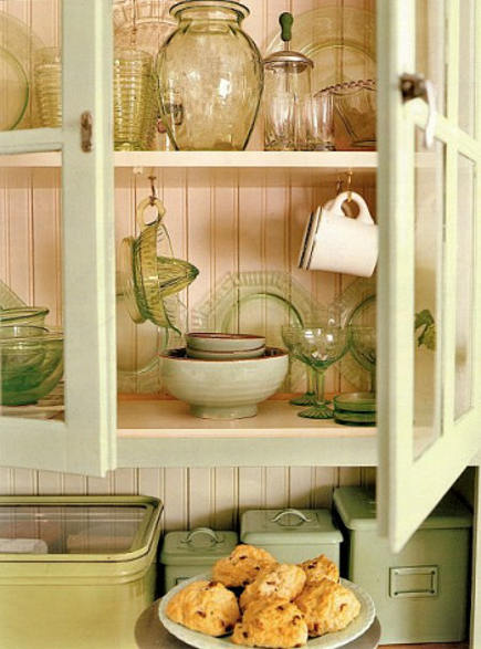 detail of glass-front cabinets in green retro cottage kitchen - Country Living via Atticmag