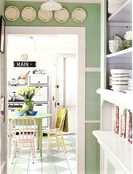 pantry area looking into the green retro cottage kitchen- Country Living via Atticmag