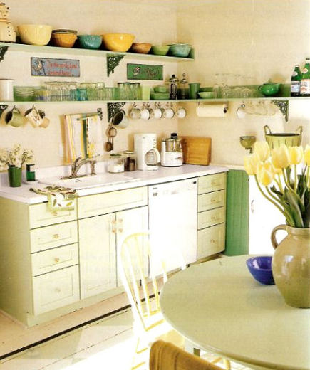 sink area of green retro cottage kitchen - Country Living via Atticmag