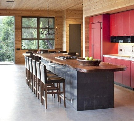 modern camp kitchen - red cabinets and large metal island with reclaimed walnute countertop by CCS Architecture via Atticmag