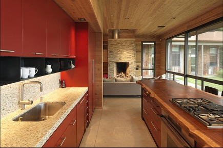 modern camp kitchen - red cabinets and reclamined walnut island by CCS Architecture via Atticmag