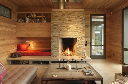 modern camp kitchen - stacked stone fireplace with built-in reading bed nook - CSS Architecture via Atticmag