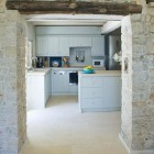 modern kitchen in an ancient stone house on the Rou Estate in Corfu - Clive Nichols via Atticmag