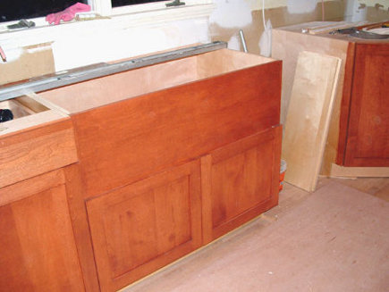 farm sink installation - an uncut sink base with the full panel - Atticmag
