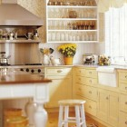 yellow and white kitchen with yellow brocade wallpaper on an accent wall - Traditional Home via Atticmag