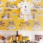 Sheila Bridges kitchen with her yellow Harlem toile de jouy wallpaper and Tord Boontje cukoo clock - Domino via Atticmag