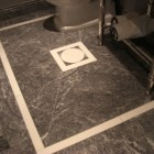 marble bathroom floors - dark gray marble show house tile floor with white geometric design - Atticmag