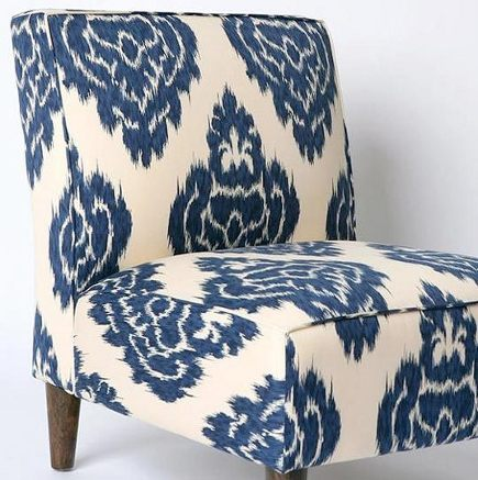 woad blue - batik print blue and white fabric on slipper chair - via Atticmag