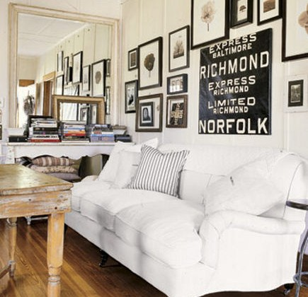 bus scrolls - living room with vintage bus scroll used as wall art - Country Living via Atticmag