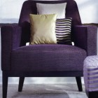 purple chair with accent pillows in coordinating fabric scheme