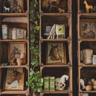repurposed shelving - vintage wooden crates used as wall shelves for displaying a horse collection - Holly Mathis Interiors via Atticmag