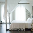 romantic bedroom - white bedroom with canopy bed by Kara Mann via Atticmag
